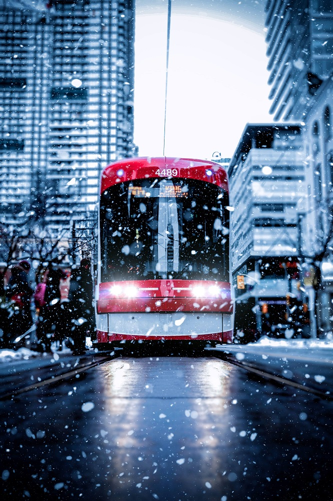 snowy road with bus