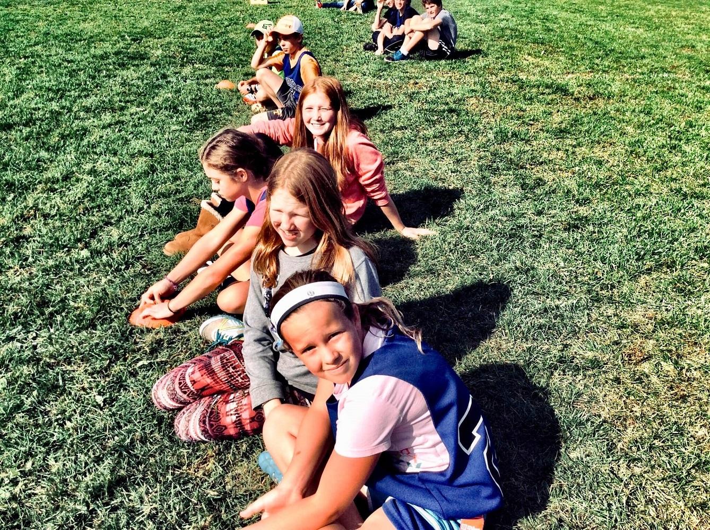 kids sitting in a field