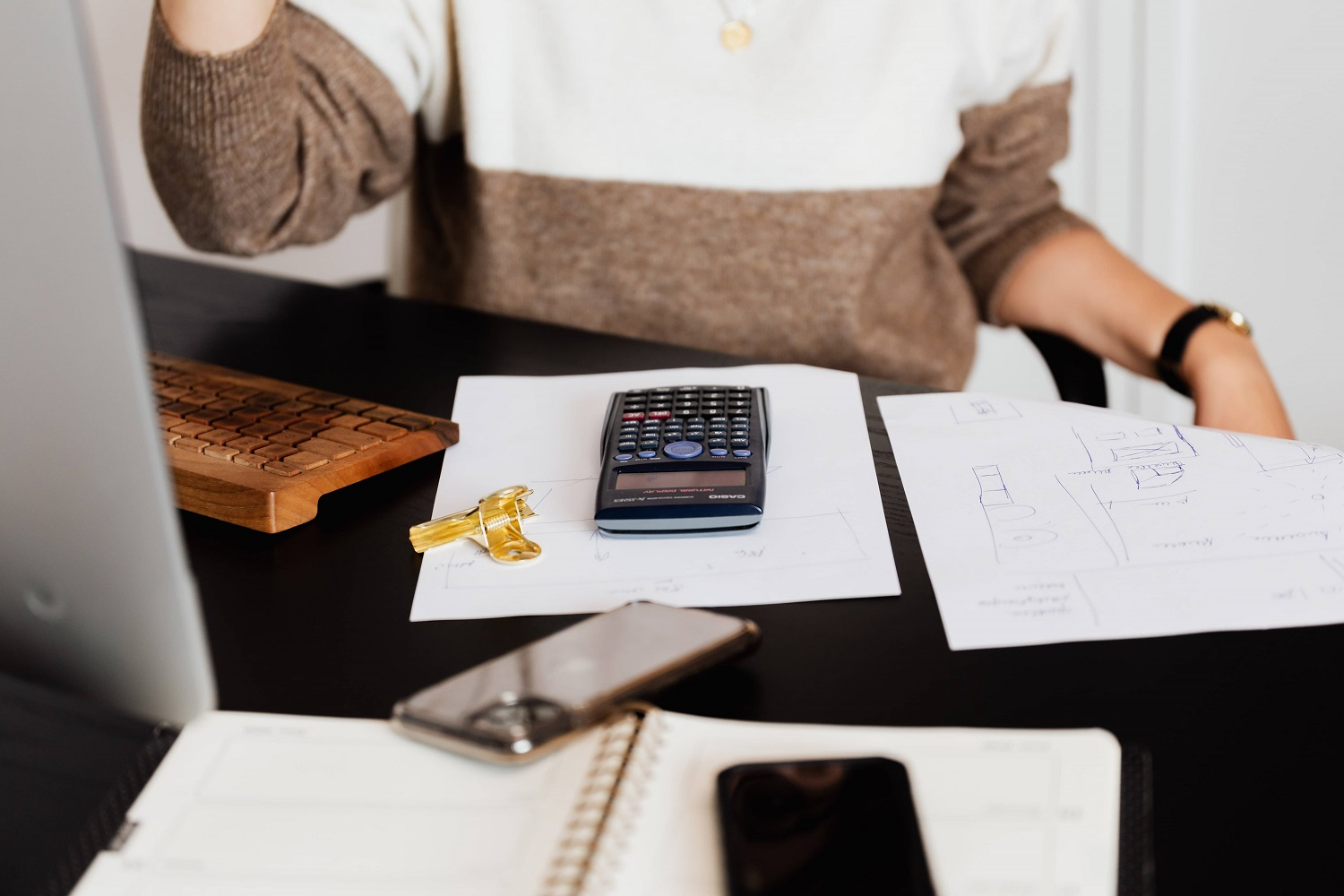 desk with papers and calculator