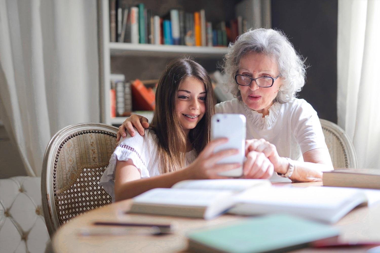 girl and grandma on cellphone