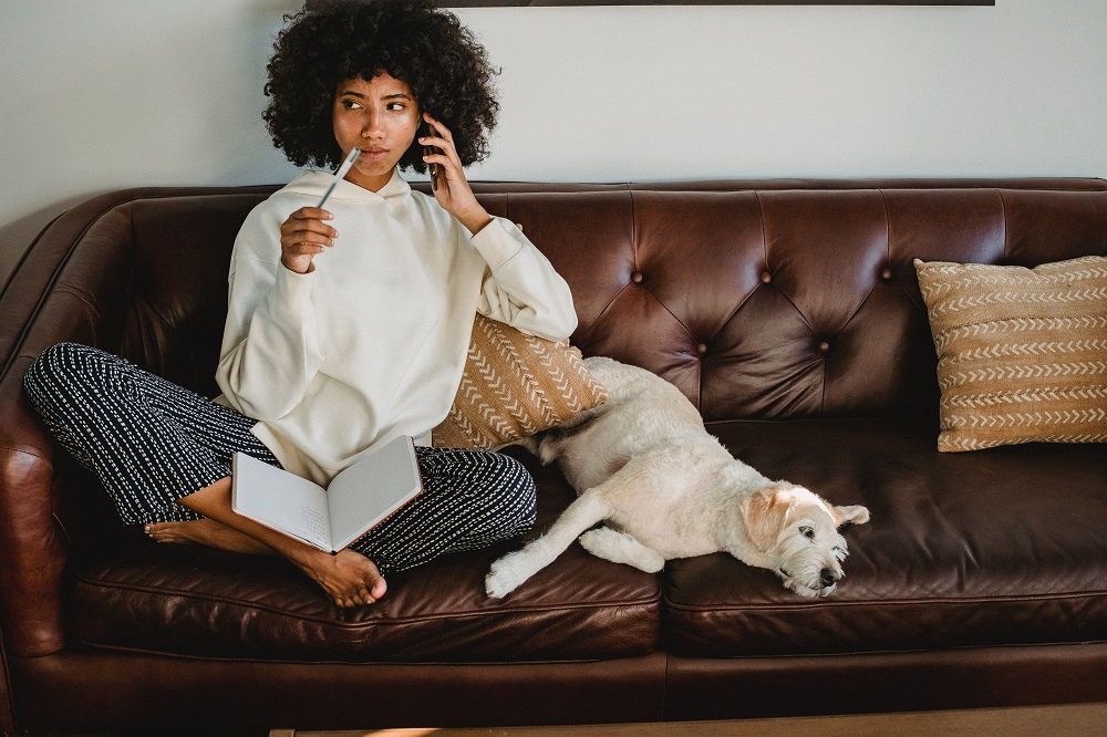 Woman on a couch with a day planner