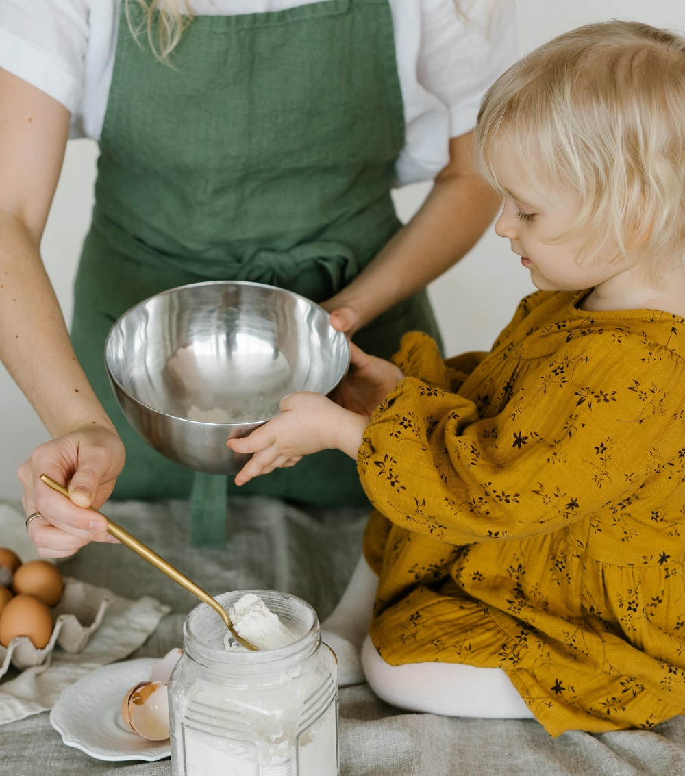 young girl holding a baking bowl