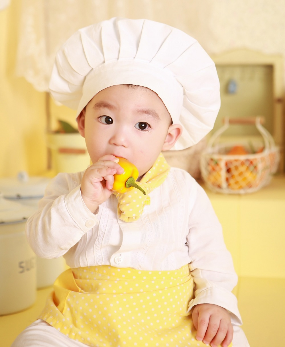 child wearing a chef hat